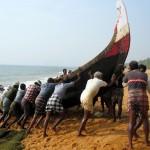 Fiskare på väg ut i södra Indien- Kerala