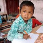 Flitig tibetansk pojke